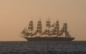 A beautiful 5-master setting sail in the sunset