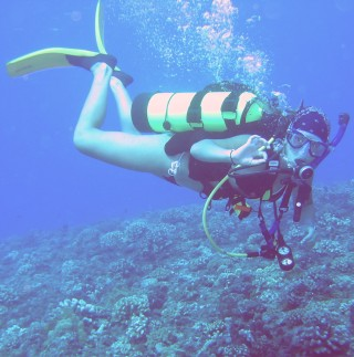 Amanda gives the OK sign on a dive in Tahiti.