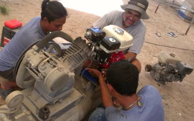 Houa, Baw & Jon fit the new motor onto our compressor