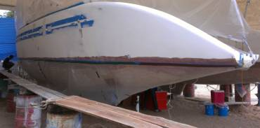 Port topsides masked and ready for spraying with gelcoat