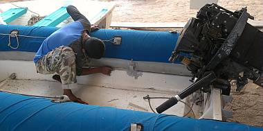 Baw and Heru started working on Tom Cat, our big dinghy