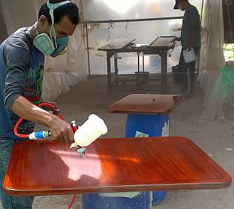 Baw spraying TOA 2-part polyurethane on salon tables