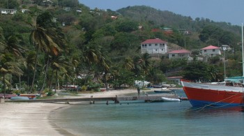 Bequia beach and the red bow of a wooden work boat