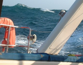 Big waves looking off the quarter from the companionway