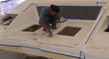 Jack touching up some spots on the foredeck