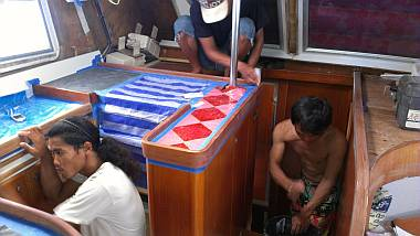Chambron, Heru, & Yando sanding the high-wear trim in the salon