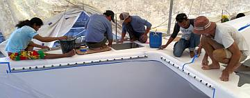 The guys cleaning the starboard side-deck