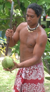 Ringa, a native of Polynesian Rotuma (Fiji) whacks open a green drinking nut.