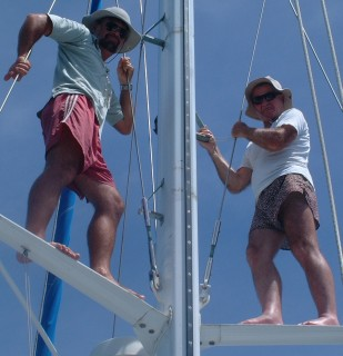 Jon & Colin up the mast, watching for coral