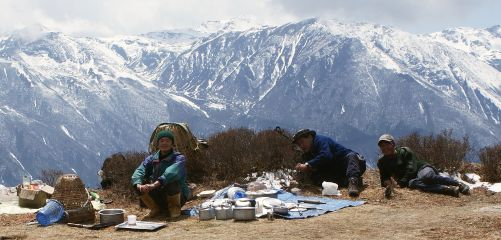 Our cook team relaxes. Lunch is ready on the high traverse above Dzongri
