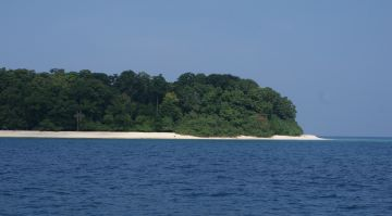 East Twin Island, Andaman Islands, & the channel. Strong current!