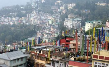 Prayer flags & roof-top view of Gangtok, Sikkim