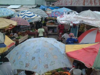 A parade of umbrellas: Open air market in Grenada