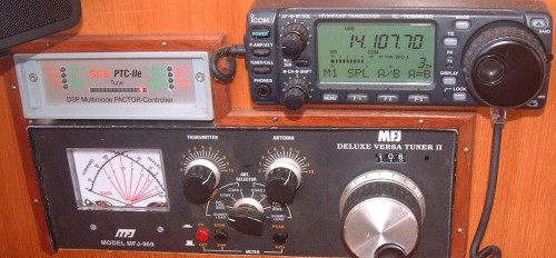 SSB Radio on right, Pactor 3 Modem on left, & Antenna Tuner on Ocelot