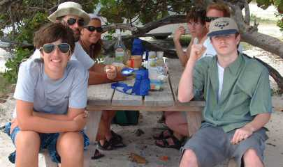 Picnic on a St. Martin beach - fresh French bread, cheese, sausage, beer, chips - YUM