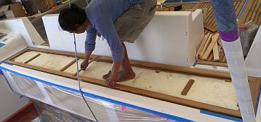 Positioning the long aft-deck frame to stick it down