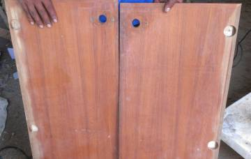 Houa's cabinet doors, with new teak on the outer edges