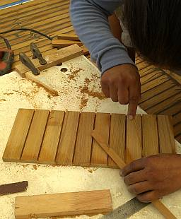 Super-gluing the teak together into a board
