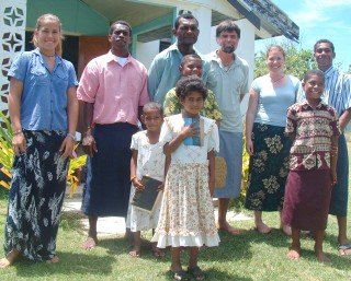 Fijians and Ocelot crew outside the church at Sese village, Yasawas