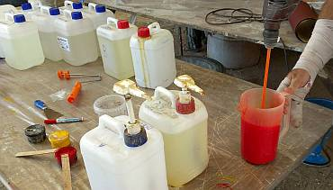 Mixing station: 50 liters of epoxy, colors, pumps, & mixing rod