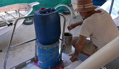 Siphoning diesel through our Baja filter & into the starboard tank