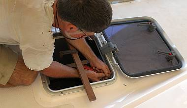 Screwing the new internal hatch trim to the hatch