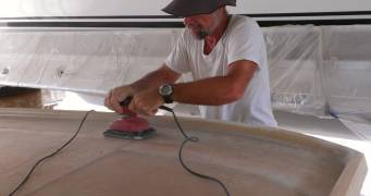 Jon sanding down the fiberglass layup from Friday
