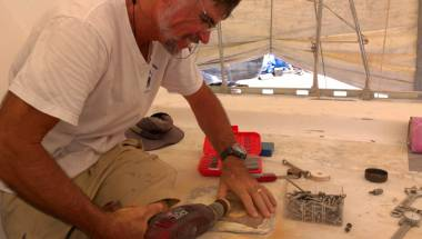 Jon making round tapered plugs with a hand-drill and sandpaper
