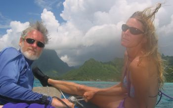 Karen & Jon riding in the dinghy to yet another Moorea dive spot
