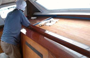 Lek sanding the big shelf on the starboard side of the salon