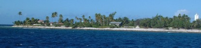 Village on Makemo atoll as we enter through the cut