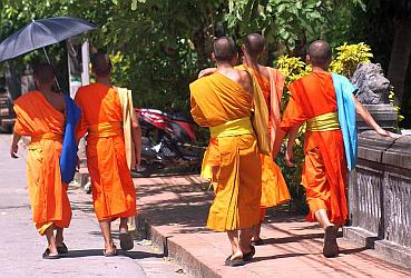 Robed monks are very colorful in the noonday sun