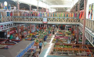 The two-story market in Papeete houses dozens of tiny stalls