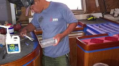 Pla brushing a 3rd layer of epoxy on high wear areas of the galley