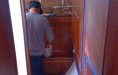 Pla sanding rough varnish in the starboard aft cabin