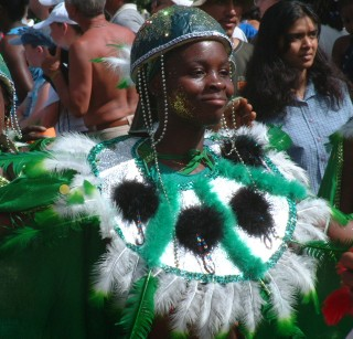One of many happy dancers, all in the finest Carnival costumes.