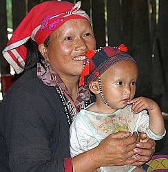 A Red Dao woman with her baby