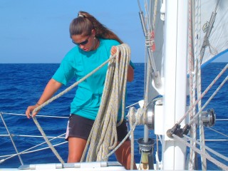 Amanda coils the halyard after shaking the reef