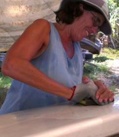 Sue wet-sanding the mast with 320 grit