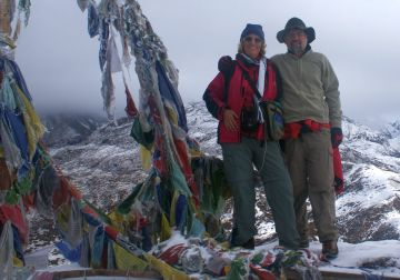 Frozen prayer flags & snowy views on Dzongri hill