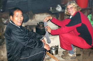 Thupten & Sue by family hearth, drying socks!