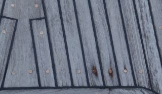 Tired teak decks, with screws up & worn down wood