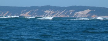 Breaking swells to the side of Wide Bay entrance